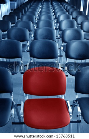 Empty conference room with one red chair