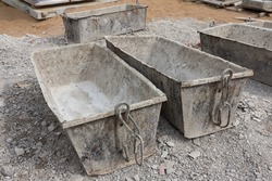 Empty construction tanks for cement. Cement mortar for brickwork