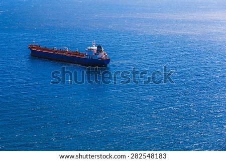 Empty container cargo ship in the open ocean or sea