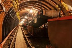 Empty conveyor belt in underground coal mine. Crisis in the mining industry