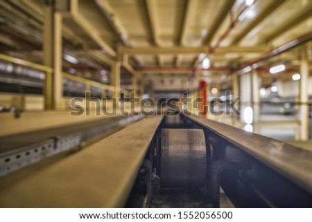 Empty conveyor belt on the production line in the background of the production interior #1552056500