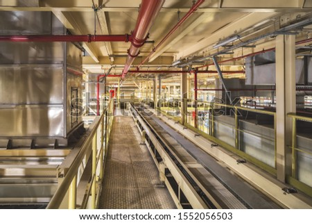Empty conveyor belt on the production line in the background of the production interior #1552056503