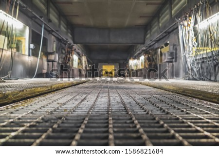 Empty conveyor belt on the production line in the background of the production interior