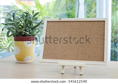 Empty cork board on the table