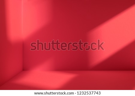 Empty corner of red room with deep window shadow. Minimalistic space concept #1232537743