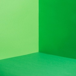empty corner with green walls and floor