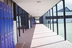 Empty corridor at school during sunny day