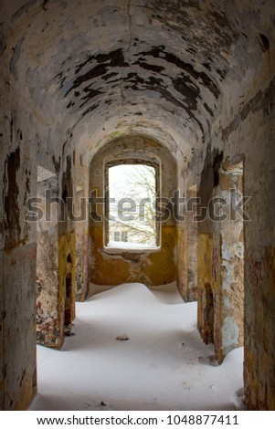 Empty corridors of an abandoned prison building of the late 19th century in Borovsk, Russia #1048877411