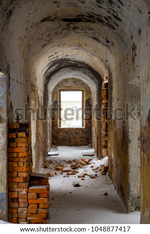 Empty corridors of an abandoned prison building of the late 19th century in Borovsk, Russia #1048877417