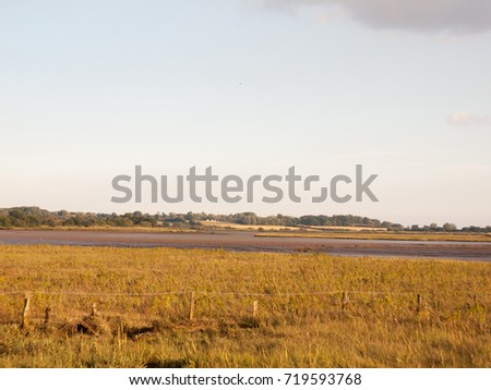 empty country coastal scene with river and clear sky; England; Essex #719593768