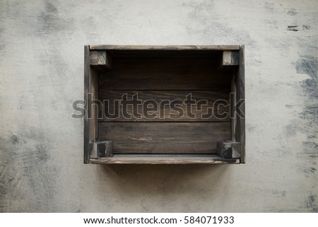 Empty crate of fruit on background of shabby gray marble. Top view, copy space #584071933