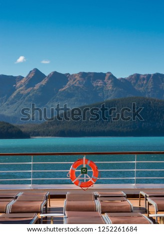 Empty cruise ship lounge chairs and life ring, Lido Deck. Alaska, USA.