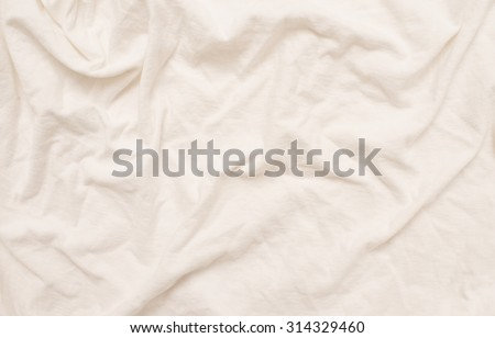 Empty crumpled white bed sheet.