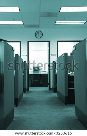 Empty cubicles in an office, clock on the wall showing lunchtime.  Color tinted to fluorescent green to enhance corporate mood