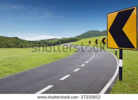 empty curve road with turning left sign