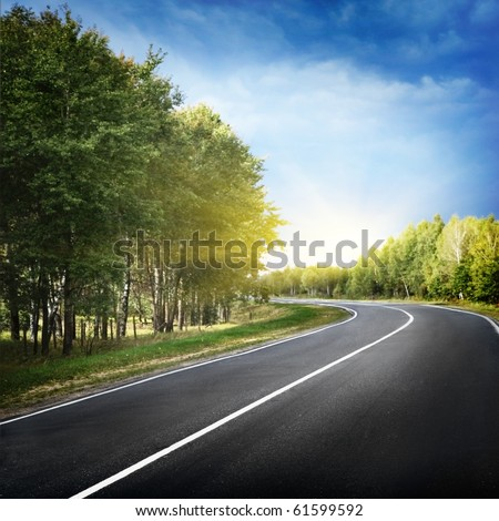 Empty curved road,blue sky and sun. #61599592