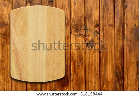 Empty cutting board on a wooden table.Top view