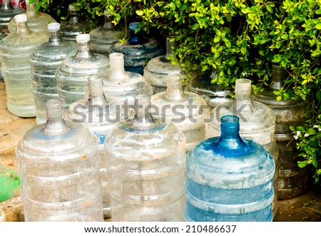 Empty damaged plastic water bottles. Many indians do not have access to clean drinking water an must rely on locally bottled water for consumption