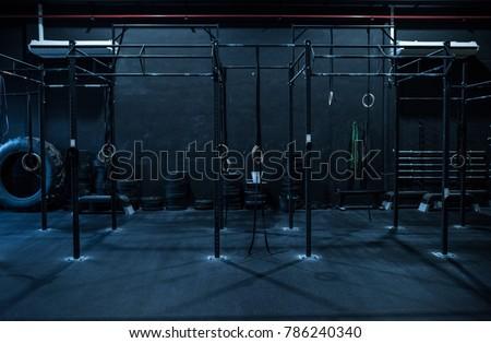 Empty dark rings and chin bar room at gym