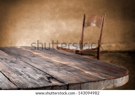 empty dark table and chair in interior