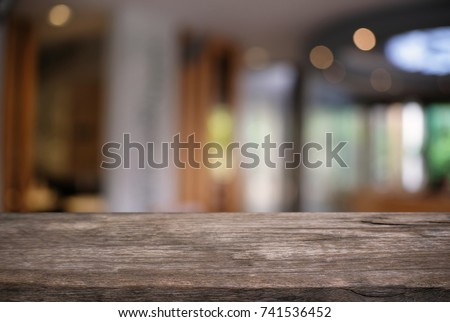 Empty dark wooden table in front of abstract blurred background of coffee shop . can be used for display or montage your products.Mock up for display of product. #741536452