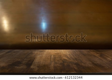 Empty dark wooden table in front of abstract blurred background of dark wood . can be used for display or montage your products.Mock up for display of product #612132344