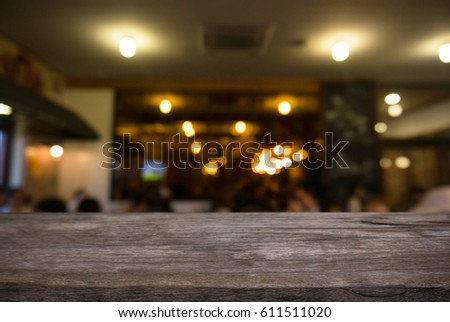 Empty dark wooden table in front of abstract blurred background of restaurant . can be used for display or montage your products.Mock up for display of product #611511020