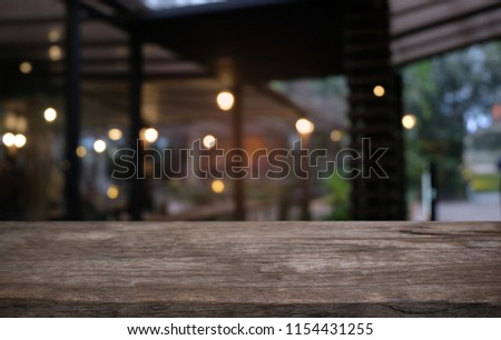 Empty dark wooden table in front of abstract blurred bokeh background of restaurant . can be used for display or montage your products.Mock up for space #1154431255