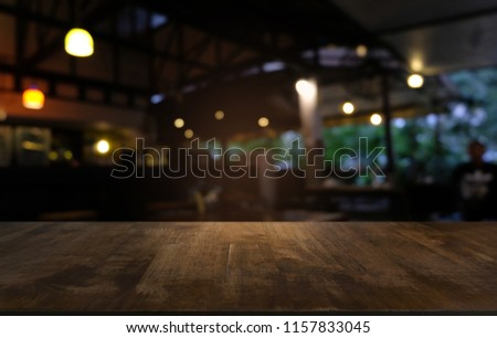 Empty dark wooden table in front of abstract blurred bokeh background of restaurant . can be used for display or montage your products.Mock up for space #1157833045