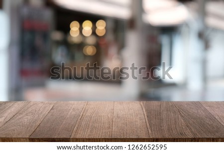 Empty dark wooden table in front of abstract blurred bokeh background of restaurant . can be used for display or montage your products.Mock up for space #1262652595