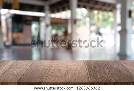 Empty dark wooden table in front of abstract blurred bokeh background of restaurant . can be used for display or montage your products.Mock up for space #1265966362