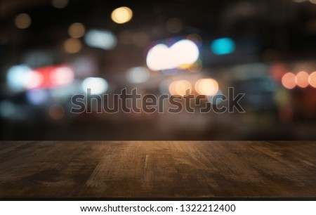 Empty dark wooden table in front of abstract blurred bokeh background of restaurant . can be used for display or montage your products.Mock up for space  #1322212400