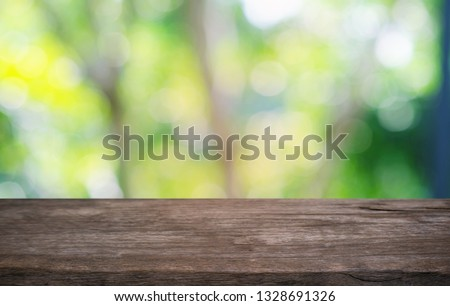 Empty dark wooden table in front of abstract blurred bokeh background of restaurant . can be used for display or montage your products.Mock up for space  #1328691326