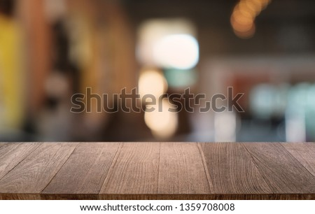 Empty dark wooden table in front of abstract blurred bokeh background of restaurant . can be used for display or montage your products.Mock up for space  #1359708008