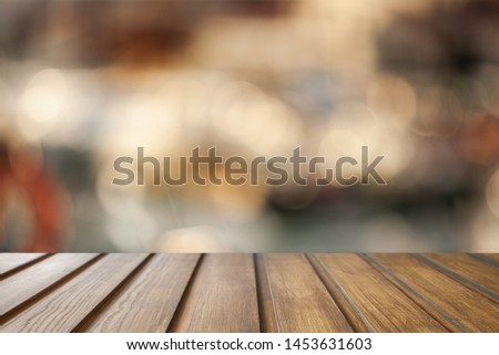 Empty dark wooden table in front of abstract blurred bokeh background of restaurant . can be used for display or montage your products.Mock up for space.          - Image #1453631603