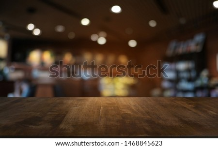 Empty dark wooden table in front of abstract blurred bokeh background of restaurant . can be used for display or montage your products.Mock up for space  Foto stock ©