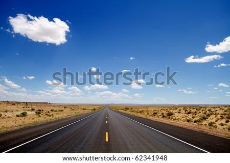 Empty desert road stretching to horizon