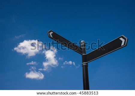 empty direction sign against beautiful blue sky
