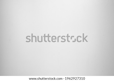 empty dirty frosted glass or blank translucent old window and unclean dim wall in bathroom or shower room with white light vignette for black texture or dark background and opaque wallpaper Stockfoto ©