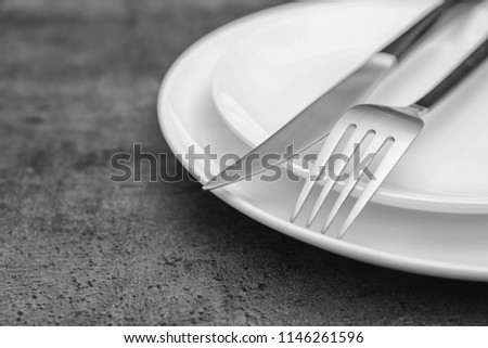 Empty dishware and cutlery on gray background, close up view. Table setting #1146261596