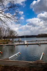 Empty docks in the port of Scharmuetzelsee, Brandenburg, Germany. Empty docks in spring in the open air at noon.