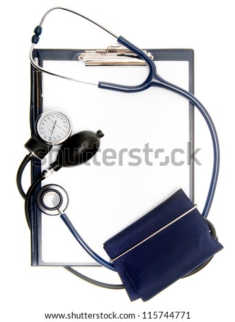 Empty document in a clipboard with sphygmomanometer and stethoscope isolated on white