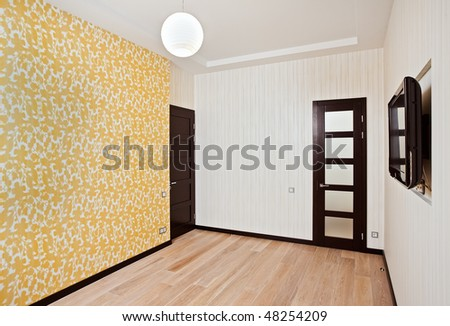 Empty drawing room interior with door and TV