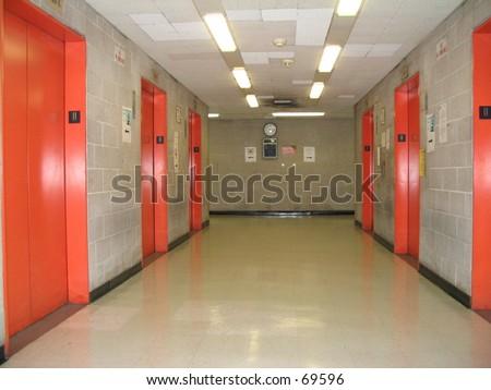 empty elevator banks, school corridors