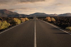 Empty endless highway through the volcanic landscape with copy space