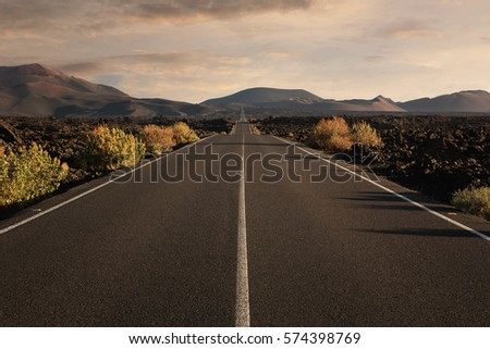 Empty endless highway through the volcanic landscape with copy space #574398769
