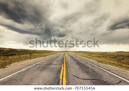 Empty endless highway through Wyoming landscape #707155456
