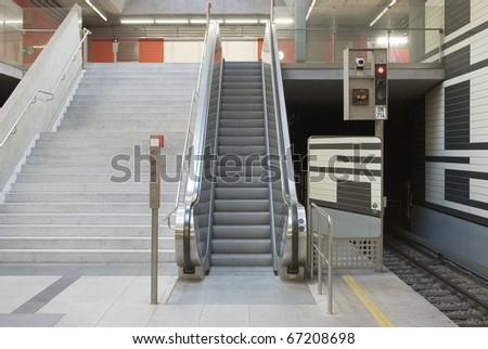 Empty Escalator at a Subway Station - stock photo
