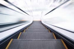 Empty escalator going down with motion blur