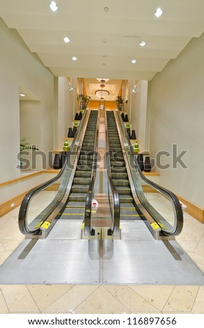 Empty escalator stairs. Fragment of the lobby of the five stars hotel. Interior design.